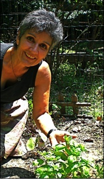 Ana Negron planting vegetables